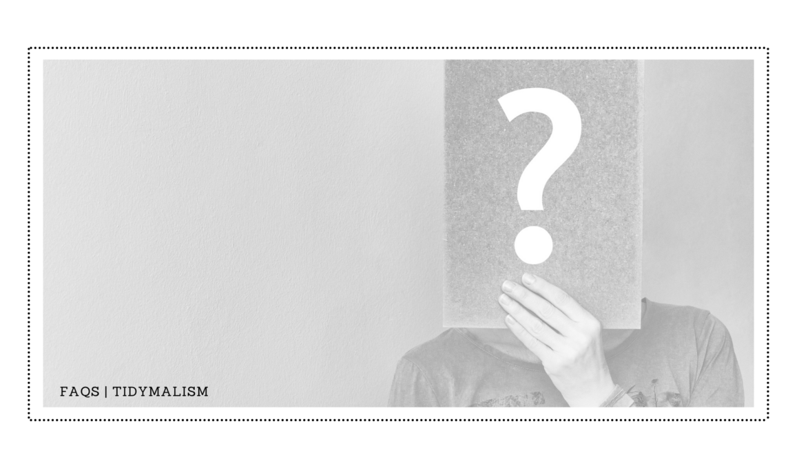 Low-contrast grey and white photo for an FAQ page of a woman holding a big question mark on a piece of paper in front of her face.