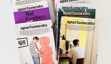 Photo of two piles of Apartamento magazines spread out neatly on a white table.