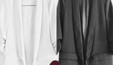 """Juxtaposed photo of two identical blazers from Zara, one in white and one in black. A little """"voila"""" emoji was added as an overlay to the image composition."""