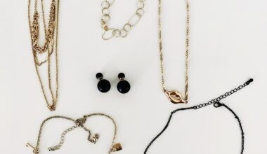 Photo of six pieces of costume jewelery on a white table