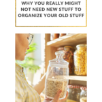 Cropped photo of a woman standing in front of her pantry shelves, holding a repurposed glass container of dried goods. Her pantry is tidy and only organized with sustainable glass jars she has kept from other foodstuffs. Caption reads: Sustainability. Why You Really Might Not Need New Stuff to Organize Your Old Stuff.