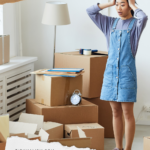 Asian woman in her late twenties wearing a denim romper and standing amongst a bunch of half open cardboard boxes. She looks overwhelmed because she's holding her head with both hands as if the mess is too much for her to deal with. Caption reads: Quick Guide to Getting Rid of Stuff After Decluttering and directs to an article about what to actually do with all the household items you've decluttered in an environmentally sustainable and responsible way.
