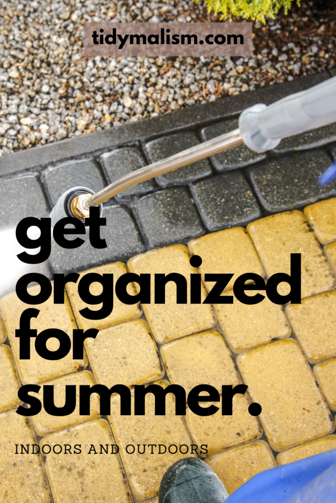 Power washing your patio, deck, or terrace before the hot weather starts is just one thing you should have on your to-do checklist to get organized for summer. Image shows a pressure washer nozzle cleaning outdoor patio pavers. The image is for a blog post about getting everything at home organized for the summer so that you can enjoy the warmer weather without worrying about chores, housekeeping, or home repairs and maintenance. For more tips on summer home organization visit tidymalism.com.