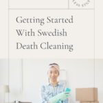Young lady standing in front of piles of tidily packed boxes, wearing aqua-colored rubber gloves and holding a matching sponge and cleaning bucket. She looks quite satisfied with her decluttering work. Caption reads: Review. Getting Started With Swedish Death Cleaning. Tidy Home, Less Stuff.