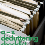 File cabinet full of hanging file folders. Caption reads A-Z Decluttering Checklist with Free PDF, www.tidymalism.com
