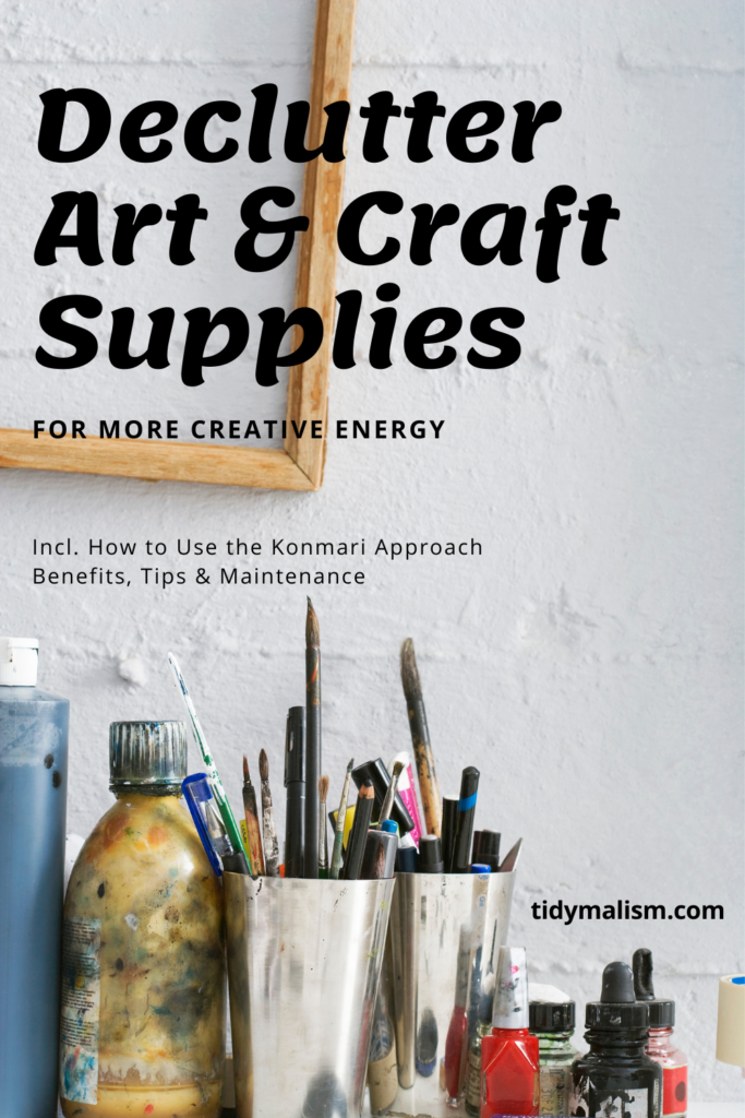 A row of random art supplies in front of a white stonewashed wall, including paints, terpentine, brushes, pencils, cutter knives and assorted dyes and tints. Caption reads: Declutter Art and Craft Supplies for More Creative Energy, including how to use the Konmari approach, benefits, tips and maintenance after decluttering art supplies. Tidymalism.com.