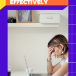 Young lady sitting over her laptop in her home office, holding her face in her hand because she is having trouble working from home effectively.