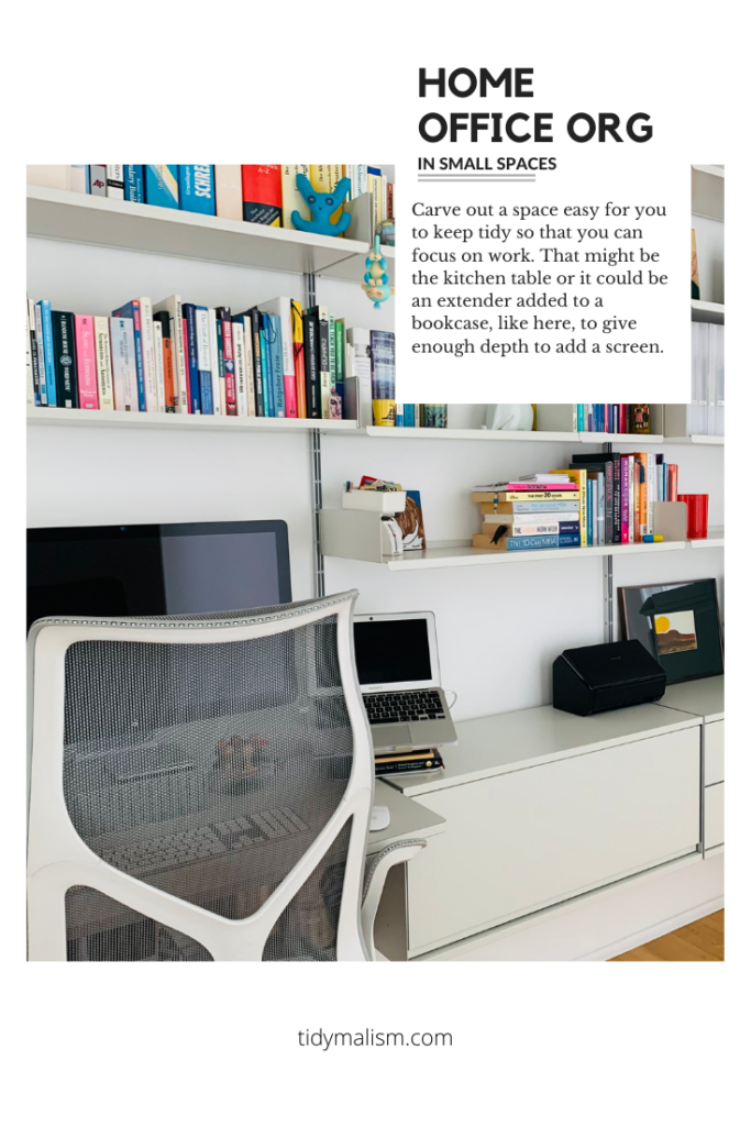 Picture of a white Vitsoe 606 bookshelf designed by Dieter Rams, in a small home office space. The walls are white and in front of the shelving unit is a Cosm chair from Herman Miller. There is an extender shelf on the lower half of the unit, the depth of which has room for a computer screen and a laptop stand. The room is very bright and tidy, welcoming one to settle in to home office work.