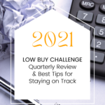 Close-up photograph of desktop calculator and crumpled up bank account statement. Caption reads 2021 Low Buy Challenge. Quarterly Review and Best Tips for Staying on Track