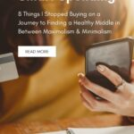Brunette lady sitting in front of an open notepad with her mobile phone in her left hand. We cannot see her face. In her right hand she is holding a credit card. Caption reads: Smart Spending. 8 Things I stopped buying on a journey to finding a healthy middle in between maximalism and minimalism.