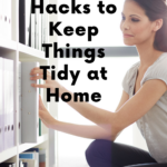Woman kneeling in front of an organized bookshelf, pulling out a binder. Behind her is a window flooding the room with light. Caption reads 10 easy hacks to keep things tidy at home, tidymalism.com.