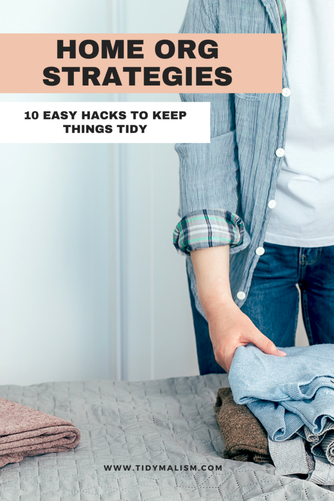 Photo of a woman folding clothing on her bed, to illustrate an article on home organisation strategies with ten easy hacks for keeping things clean and tidy at home.