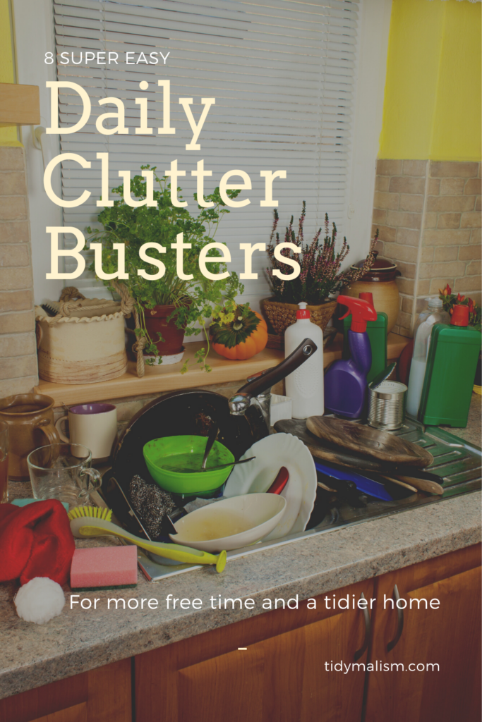Photo of a messy kitchen. The sink is full of dirty dishes piling over onto the countertop. There are spray bottles, sponges, and rags and scrubbers to the left of the sink, along with more dirty coffee mugs. Caption reads 8 Super Easy Clutter Busters for More Free Time and a Tidier Home.