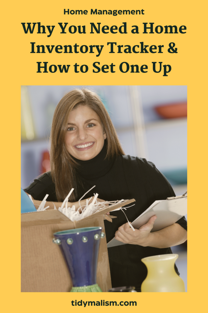 Woman with a smile on her face, holding some household items like vases in front of a box, clearly happy because she has tackled her home inventory spreadsheet and organizing.