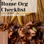 Photograph of crisp, bright brown, fallen autumn leaves in front of a broom. Caption reads Easy Autumn Home Organization Checklist: Get Set for Fall Indoors and Outdoors.